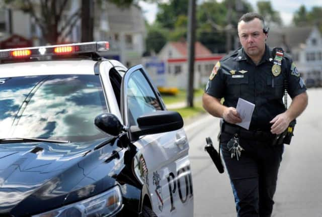 Danbury police Sgt. Rory DeRocco issues an infraction.