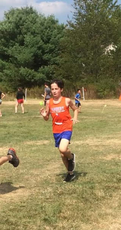 A Danbury Flyers runner runs in the recent Wilton Invitational.