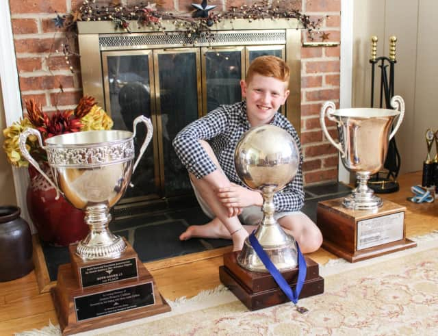 Daniel Callanan poses with three of his trophies.