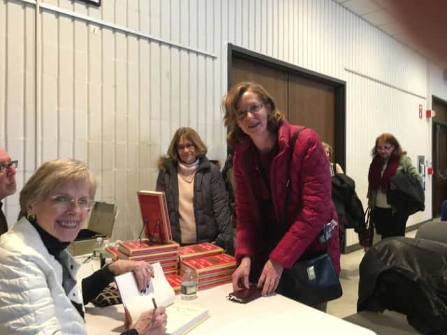 Financial writer Jane Bryant Quinn signs her new book for Yvonne Megenis of Trumbull and Judith Long of Southbury in an appearance Sunday at the Trumbull Library.