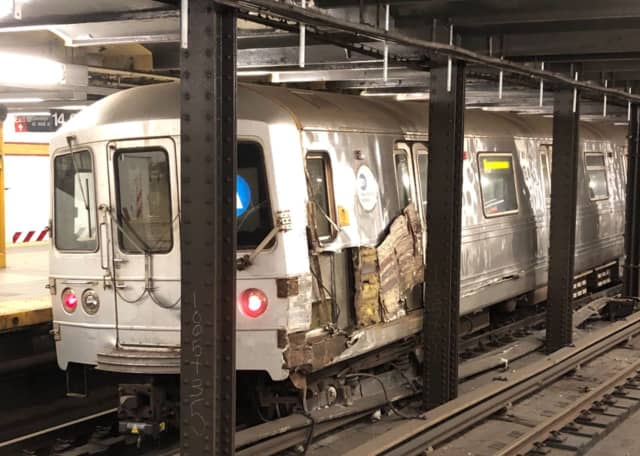 Aftermath of the derailment at the Eighth Avenue and 14th Street station in NYC's West Village.