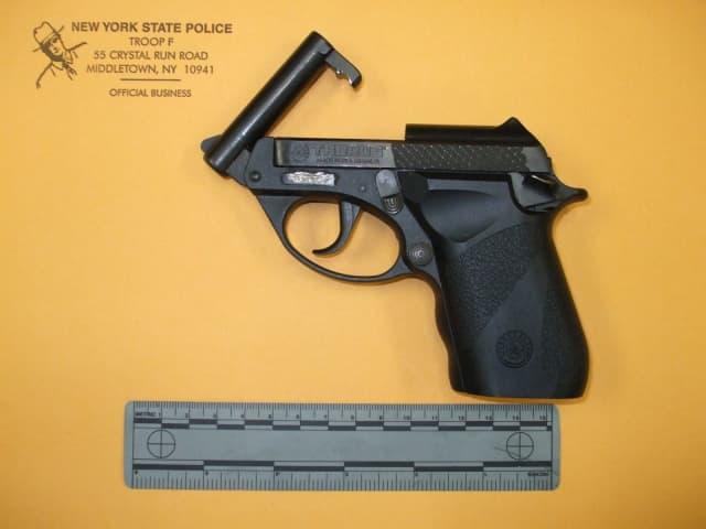 The defaced gun.