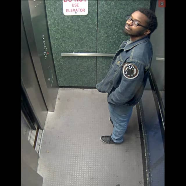 Still from CCTV of a man who allegedly pooped in a public stairwell of a Carlisle parking garage.
