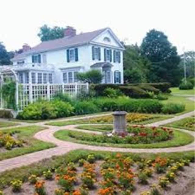 """Volunteers from the Olde Ripton Garden Club of Shelton have been helping out at the """"Holiday at the Farm"""" event at the Osborne Homestead Museum in Derby since late November. The holiday tours run through Saturday, Dec. 19."""