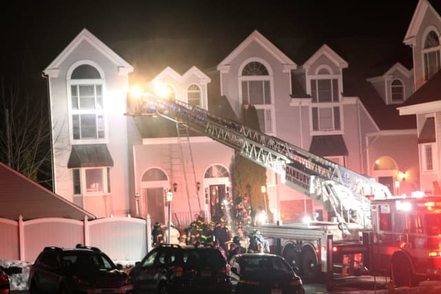 Two condo units were damaged during a two-alarm fire in Danbury.
