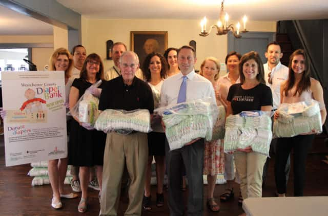 Westchester County Executive Robert Astorino, center in white shirt, and members of the Westchester County Diaper Bank celebrate one year of service to local families.