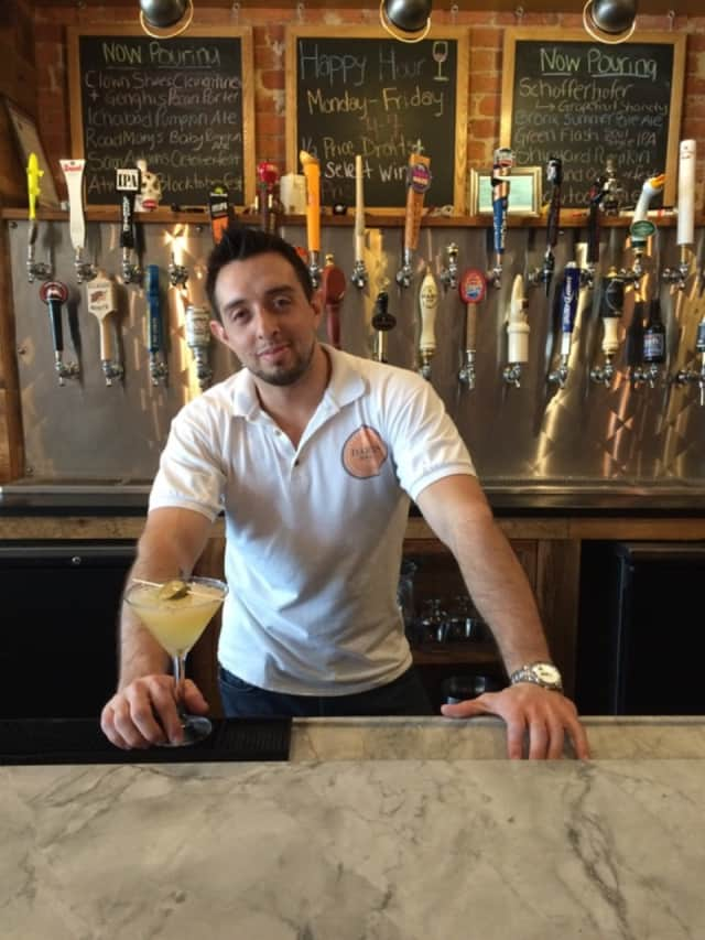 """Bartender Camilo Ramirez at Darien Social with the """"Spiked Cucumber Martini."""""""