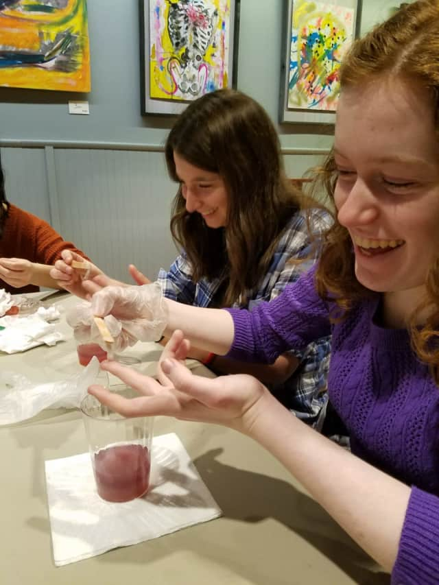 Middle school students make DNA models at the the Cultural Arts Coalition's teen science workshop.