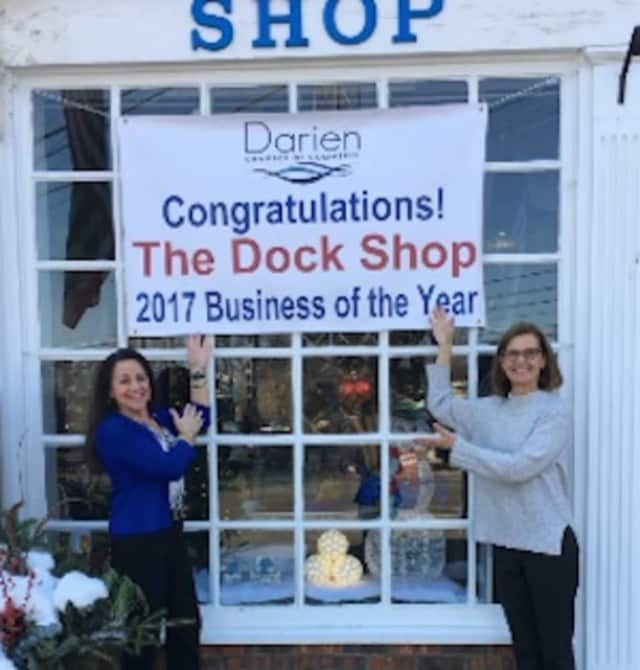 Toni Sabia, owner of The Dock Shop and Susan Cator, DCC president and executive director ,show off the banner
