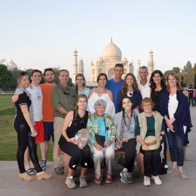 Julia B. Fee real estate agent Fiona Dogan (standing, right) traveled to India with family for an extended winter vacation. Dogan, a native of Scotland, has traveled the world.