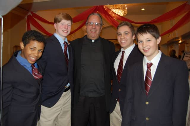 Fr. Jim Heuser with several Ironmen at last year's event.