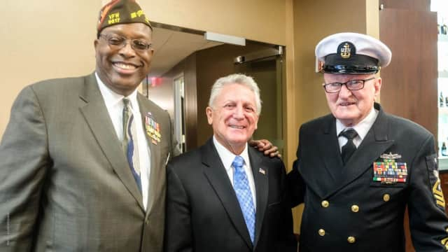 Don Burrows, right, served for more than four decades in the U.S. Navy. He is shown with Archie Elam of Stamford, left, and Norwalk Mayor Harry Rilling.