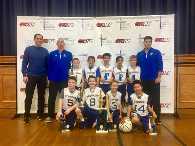 St. Gregory's state championship basketball team with their coaches. The Harrison third-graders won the state title on Sunday after a 19-0 season.