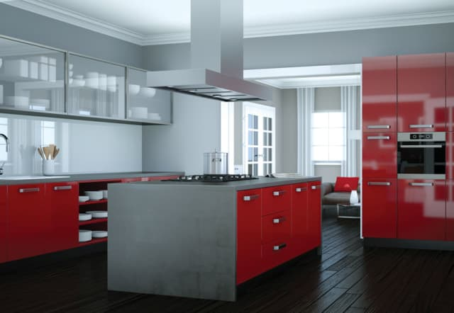 Luscious red lipsticks – eternal icons – inspire this contemporary kitchen, with crimson giving a modern pop to sedate stainless steel.