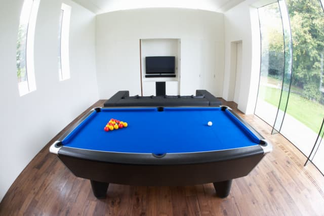 A man cave can be designed to suit any man, with accents from a pool table to a flat screen TV.