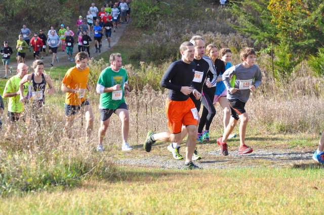 Runners head out on the 5-mile course of a previous Run the Farm race.