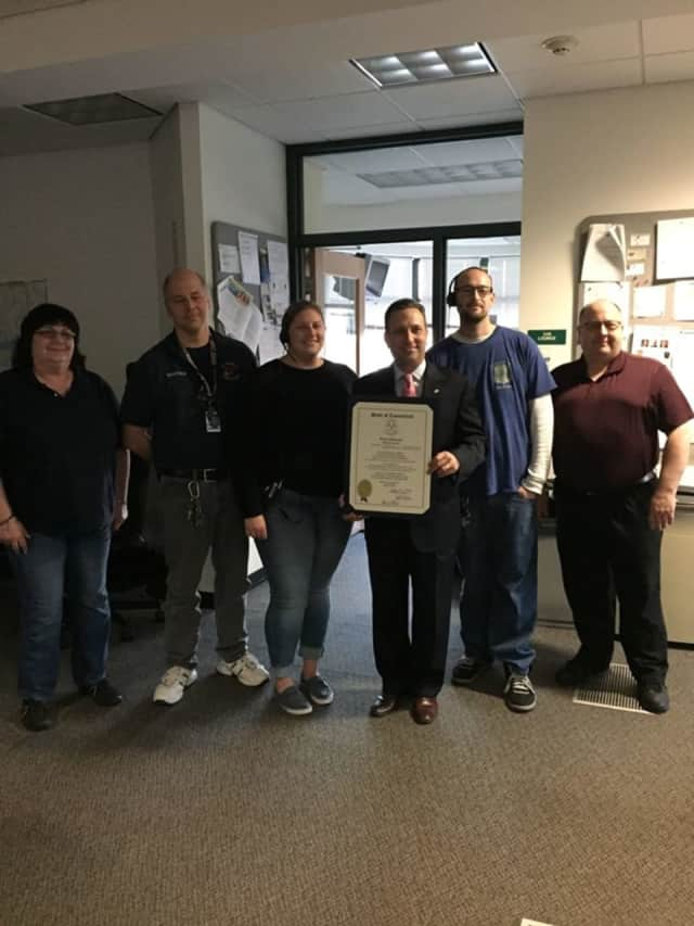Sen. Bob Duff presents a citation to Telecommunicators from Norwalk Combined Dispatch