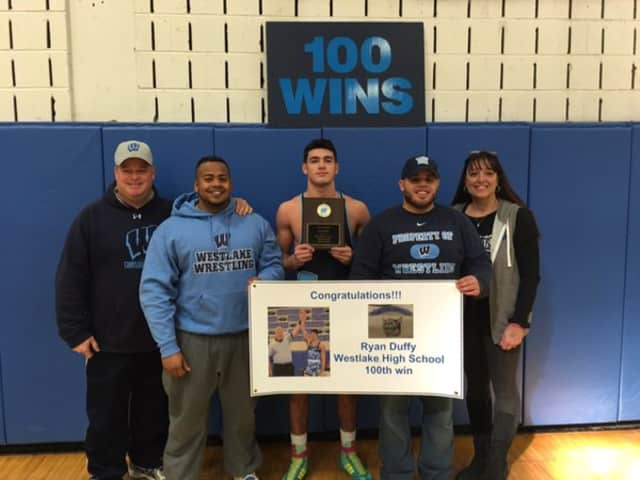 Ryan Duffy, center, is congratulated for his 100th win with the Westlake High School Wildcats. At far right is Ryan's mom, Dana; his dad, Michael, far left. Coach Randy Rodriguez is second from right; assistant coach John Lopez, second from left.