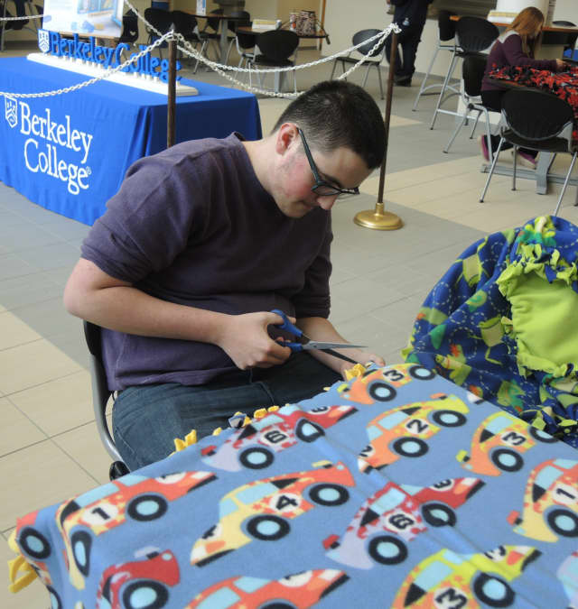 Working on the racecar blanket is Joshua Henry of Dumont.