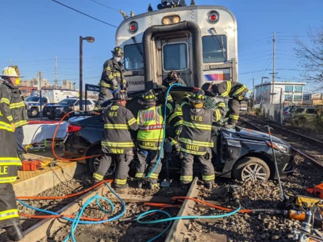 Hackensack firefighters free driver.