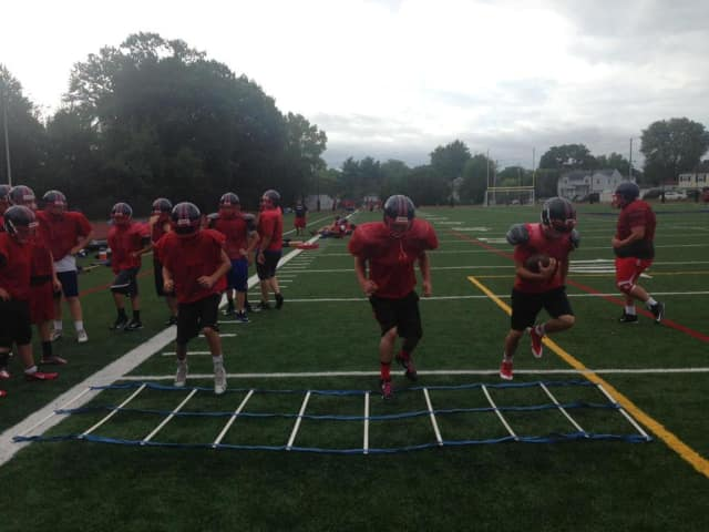 Eastchester's football team works out during summer camp.