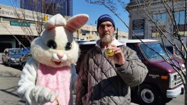 Phil Stafford with the Easter Bunny during N.J. Food & Clothing Rescue's outreach event in Newark.