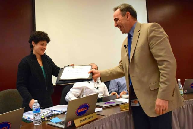 Briarcliff Manor Superintendent of Schools James Kaishian presents Board of Education Trustee Jennifer Rosen with a certificate recognizing her achievement as a Master of Boardsmanship from the New York State School Boards Association.