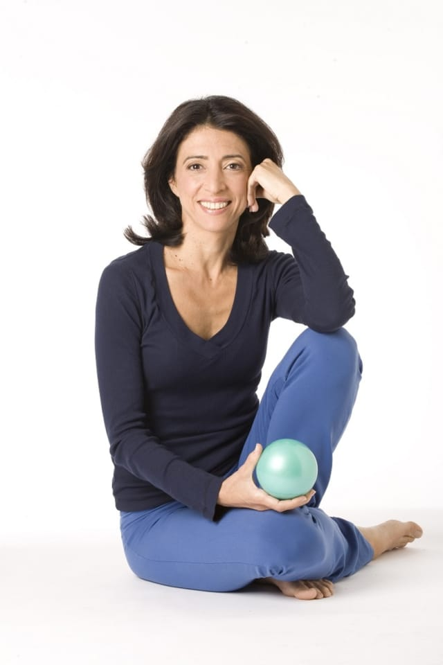 Darien resident Elaine Petrone uses a small ball to help people alleviate chronic back pain.