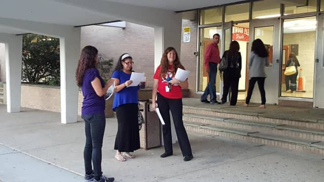 Members of the Elmwood Park Education Association gathered to organize a protest against an ongoing two-year pay freeze with no settled contract.