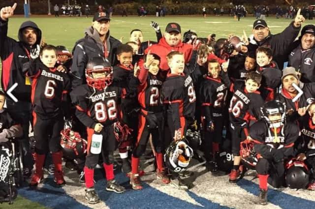 The 2014 Pee Wee Super Bowl Champion Elmwood Park Bulldogs