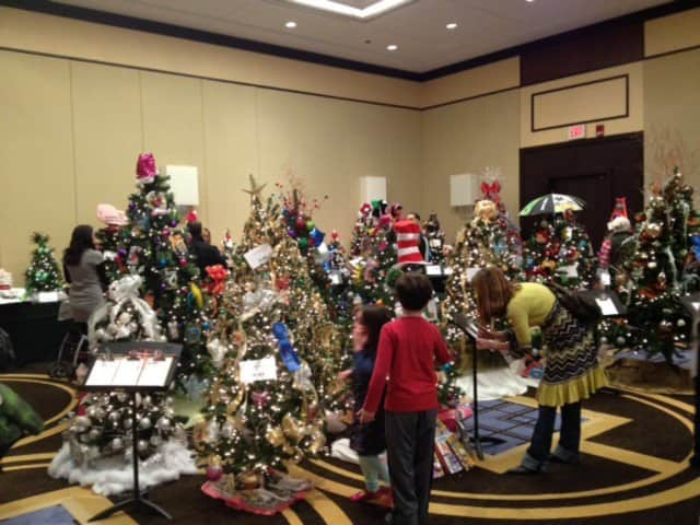 attendees of the 2012 enchanted forest fundraiser admire the christmas trees - Enchanted Forest Christmas Trees
