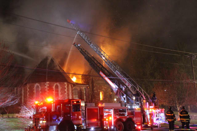 Firefighters attack the blaze at a historic church in Englewood.