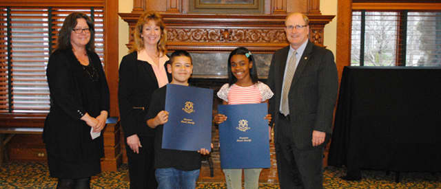 State Sen. Kevin Kelly and State Rep. Laura Hoydick congratulate two of the student winners.