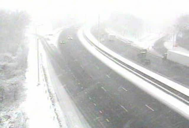 Snow is blowing and few cars are on the road at Exit 22 of I-95 in Fairfield on Friday morning.