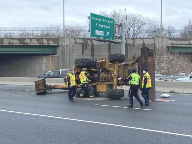 A state DOT crew was expected to check the Linwood Avenue overpass for damage.