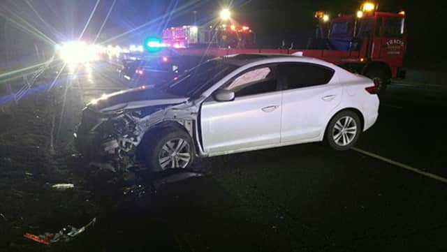 A car hit a guardrail on Route 8 Thursday evening in Shelton.