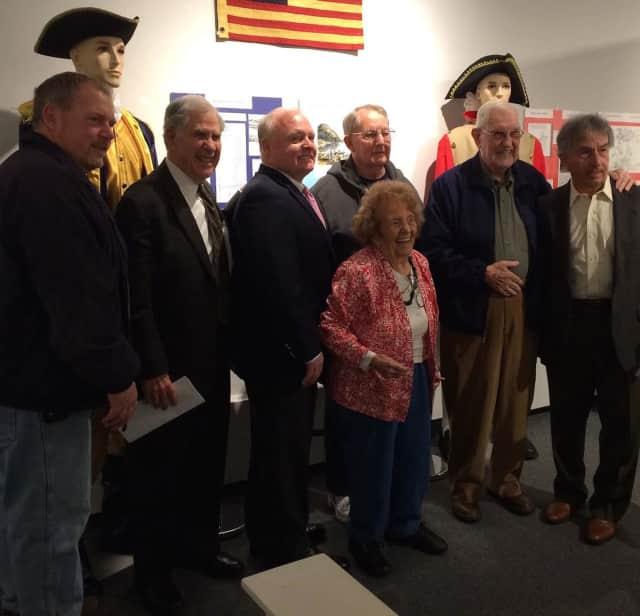 Guest curator of the Haverstraw exhibit, Corrine McGeorge, is shown with Mayor Michael Kohut, retired Judge Alfred J. Weiner, Howard Phillips, Wiliam Kohut, Joseph P. Gordon, and Isidro Cancel.