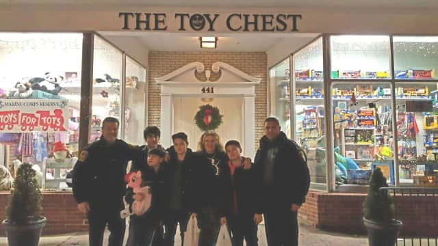 Ridgefield Police officers and participants are shown at a recent Shop with a Cop event outside The Toy Chest on Main Street.