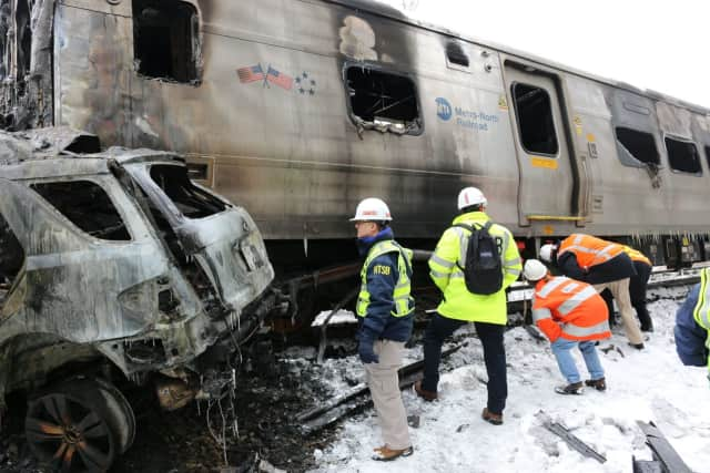 National Transportation Safety Board officials investigate the Metro-North train crash with an SUV that killed six people and injured 15 at the Commerce Street crossing in Valhalla.