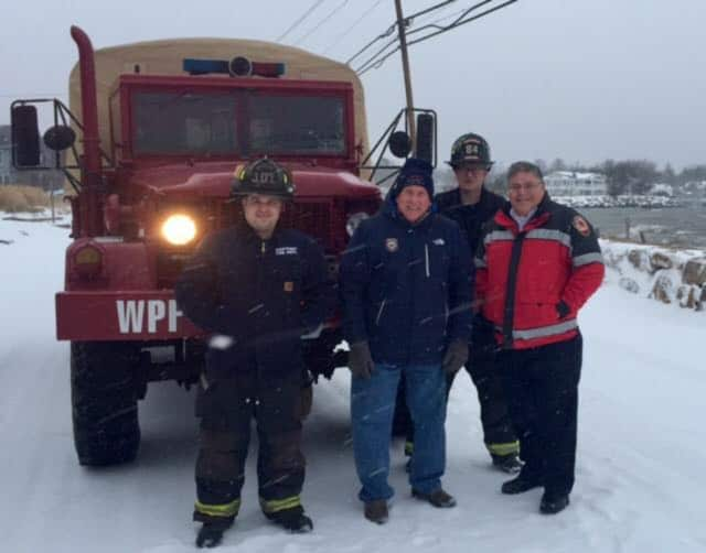 Westport First Selectman Jim Marpe joined Deputy Chief Bob Kepchar and firefighters Scott Delvecchio and Toby Ostapchuk on Harbor Road at noon where the snow had turned to wind-blown sleet and rain.