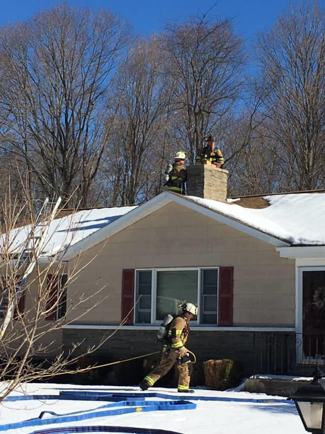 Firefighters respond to a chimney fire at a house in Shelton.