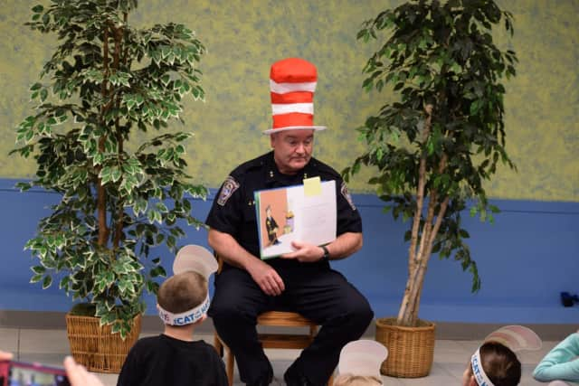 Brookfield's new Police Chief James Purcell wore a Dr. Seuss hat Thursday when he took part in a Reading Across America event at the Brookfield Library.
