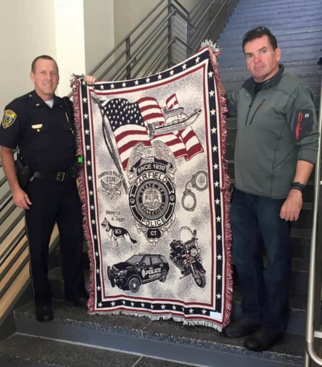 This custom throw blanket is being sold by the Fairfield Police Department to fund college scholarships.