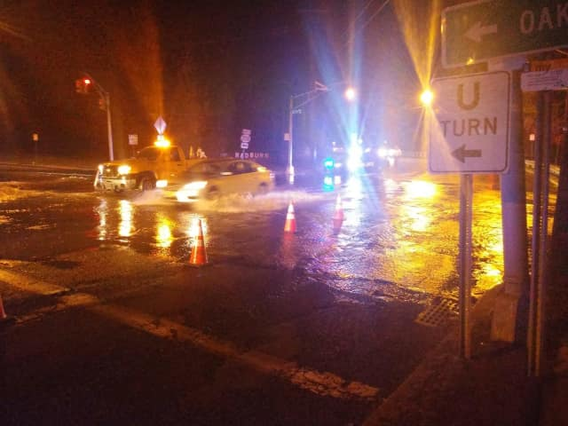 Water bubbled up across Plaza Road.