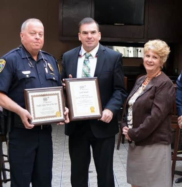 At AAA's 6th Annual Community Traffic Safety Awards lunch Public Affairs Manager Fran Mayko, third from right presented awards to Police Chief Gary MacNamara, center, and Officer Gary Wikman, left