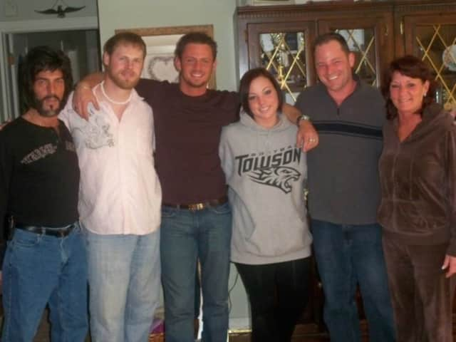Nick Arnoldi, center, with his family three years before he killed himself.