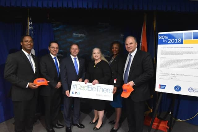 County Executive Robert Astorino, center, hosted a #DadBeThere Father's Day call for men to take control of their health, signing a pledge with the American Cancer Society uniting in a shared goal of reaching 80 percent of adults be screened.