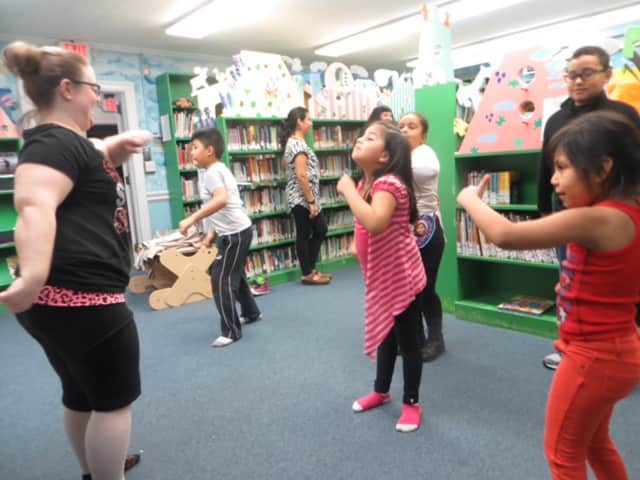 Kids learned hip hop dance from Miss Jacky while their parents learned English.