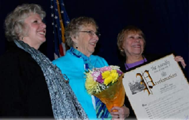 Longtime Dutchess County legislator Margaret Fettes, center, was honored in 2012 at a ceremony in Albany with a senior citizens award. Fettes died Tuesday, June 7, at the age of 90. Flags were flown at half-staff around the county in her honor.
