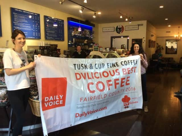 Tusk & Cup in Ridgefield proudly displays its DVLicious banner for wining best coffee in Fairfield County.